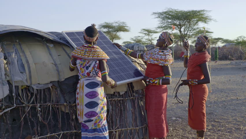 Tribal women installing solar panel. Kenya