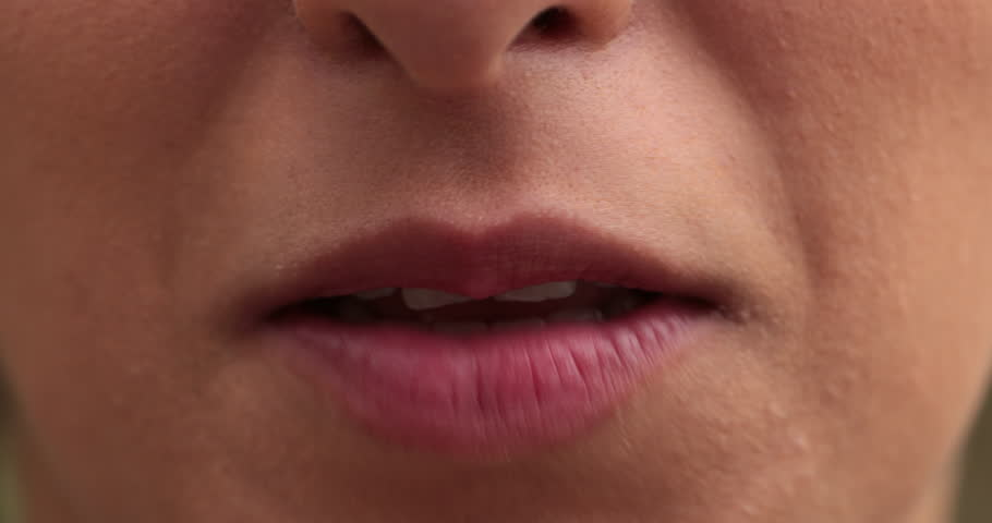 Close-up of girl lips speaking. Macro of young woman mouth speaking to viewer.   Shutterstock HD Video #1016876509