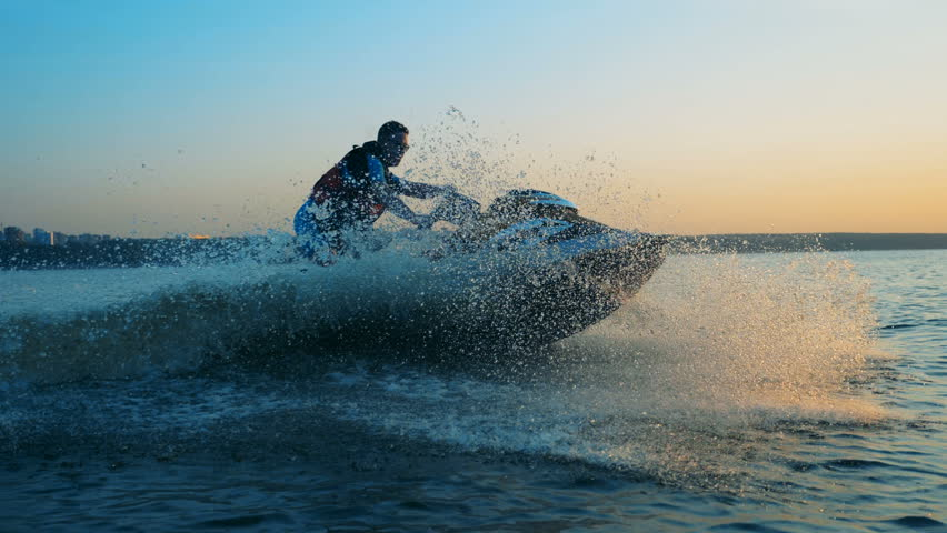 Man in a life jacket on a ski, close up.   Shutterstock HD Video #1016884561