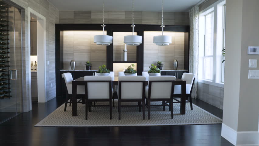 Dolly shot of pendant lights hanging over dining table at home | Shutterstock HD Video #1016891152