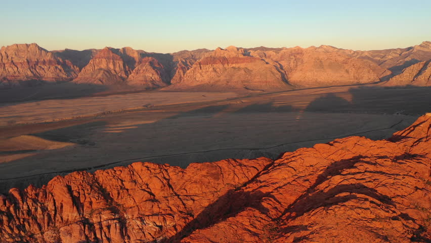 Dawn breaks on colorful mountains in Red Rock Canyon National Conservation Area, located near Las Vegas, NV. Its massive red rock geologic formations are popular for hiking and climbing. | Shutterstock HD Video #1016898412
