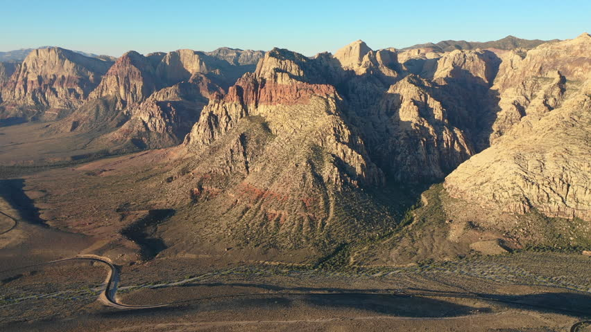 Dawn breaks on colorful mountains in Red Rock Canyon National Conservation Area, located near Las Vegas, NV. Its massive red rock geologic formations are popular for hiking and climbing. | Shutterstock HD Video #1016898424