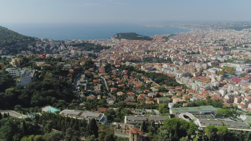 The city of Nice in the south of France on the azure coast is a view from above on the roofs of houses and roads