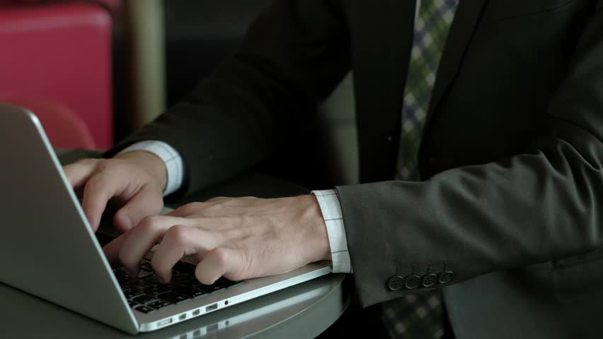 Close-up of hr-manager working on laptop then talking by phone. conducts business negotiations. personnel selection. 4k uhd.