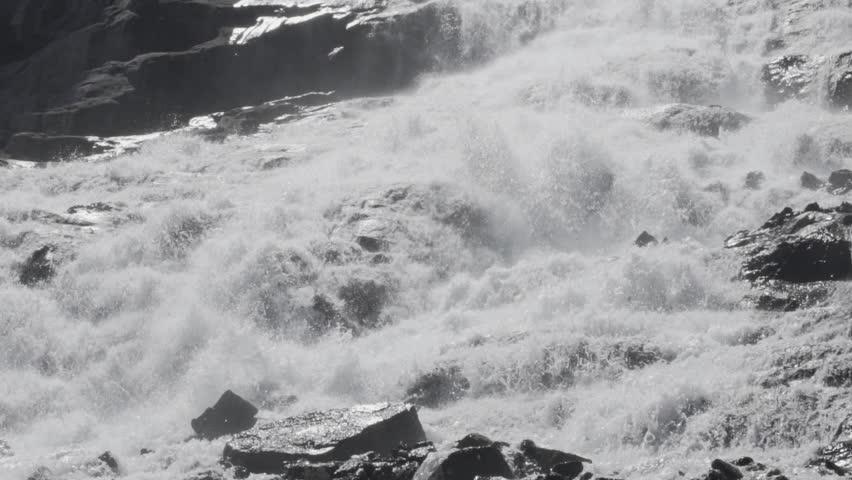 An enormous waterfall cascades down a mountainside in slow motion.   Shutterstock HD Video #1016960419