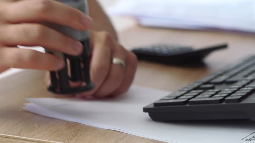Close-Up Of Stamping On The Document Royalty-Free Stock Footage #1016962582
