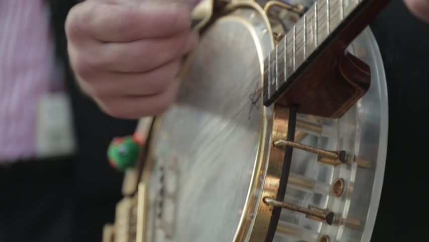 Close-Up Hands Playing the Banjo outside.