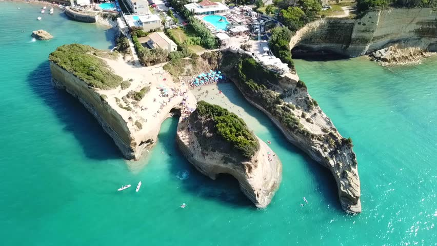 Aerial drone bird's eye view video of iconic white rock volcanic formations of Canal d' Amour in Sidari area, North Corfu island, Ionian, Greece   Shutterstock HD Video #1016991988