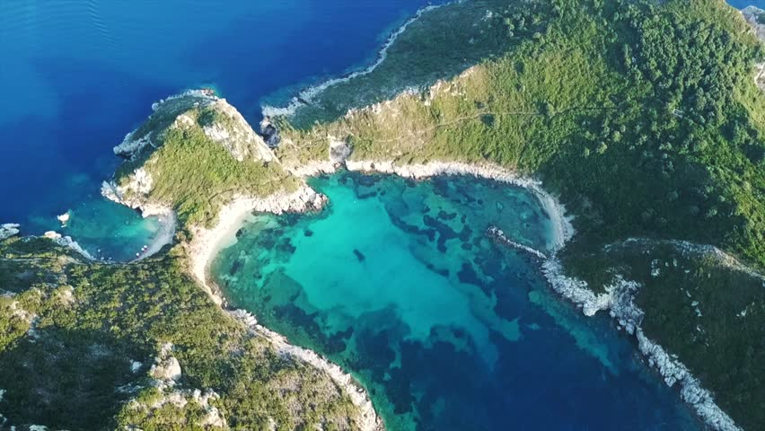Aerial drone video of iconic paradise bay of Porto Timoni with tropical deep blue and turquoise clear sea, Corfu island, Ionian, Greece   Shutterstock HD Video #1016992342