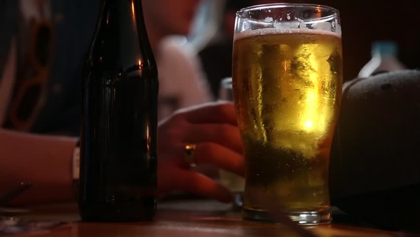 A relaxing beer in a cafe. | Shutterstock HD Video #1016992657