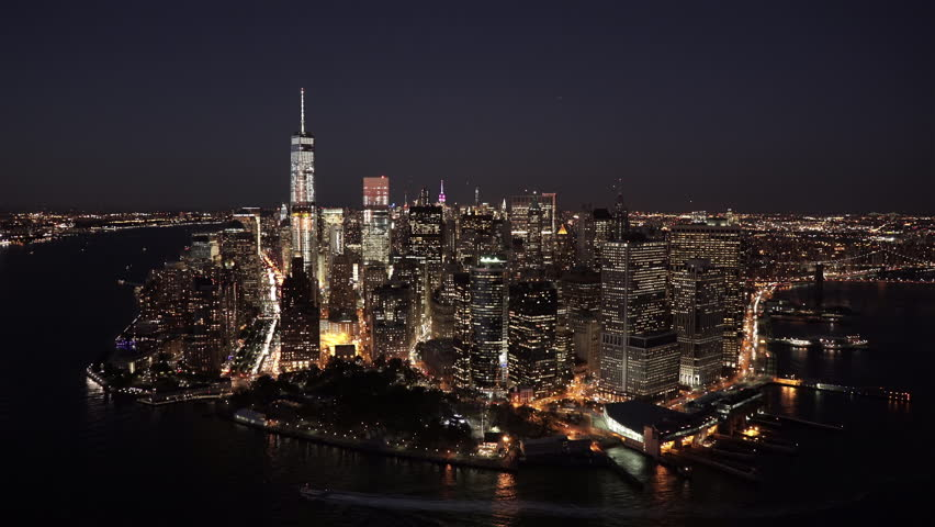 New York City Circa-2015, aerial view of Lower Manhattan Financial District at night, from Battery Park and the Staten Island Ferry Whitehall terminal, with Midtown in the background