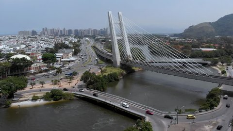 Infrastructure and Nature and architecture in brazilian neighborhood of Barra da Tijuca and your streets, bridges, railway, subway, boats. cars, bus.Lagoons, beachs and mountains.