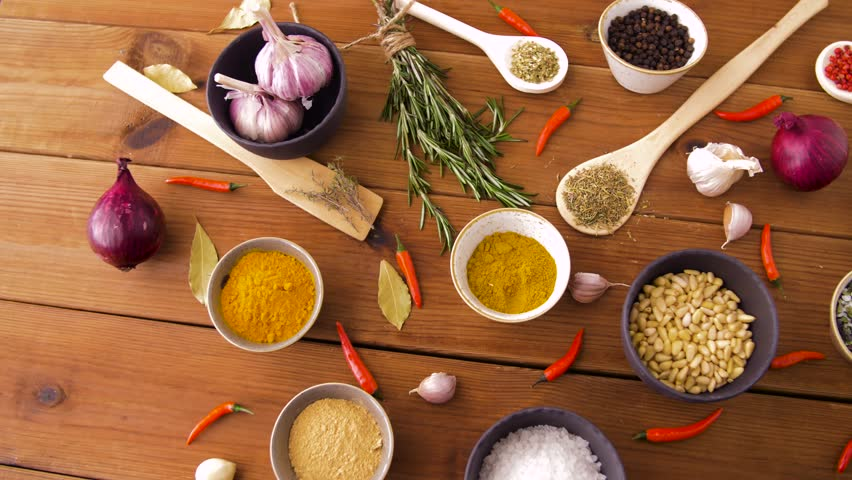 food, culinary and eating concept - different spices on wooden table #1017003172