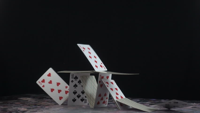 This stock video shows a stack of playing cards built into a castle. The cards topple down on its own weight. This clip is perfect for projects about the fall of a business or empire.