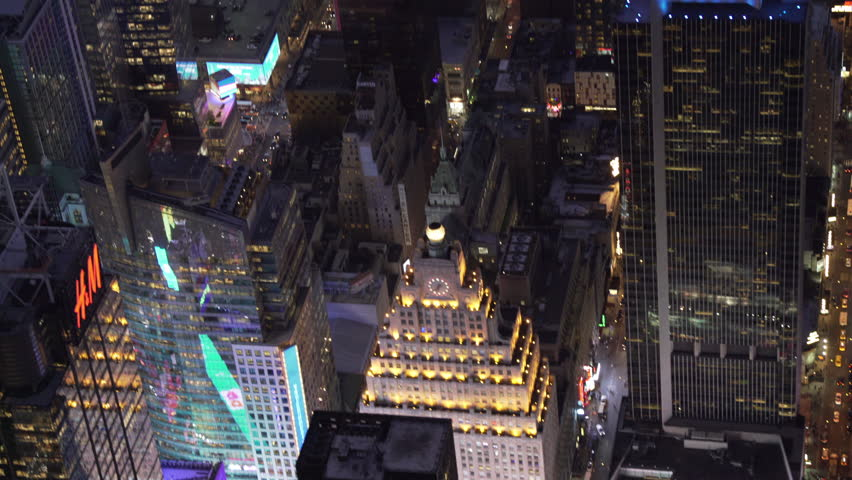 New York City Circa-2015, telephoto aerial view above Times Square and Midtown Manhattan office buildings at night