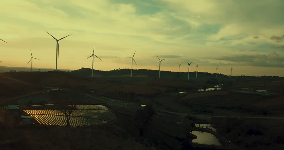 Sunset Wind Turbine, Aerial view sunrise from Drone flying Wind turbines produce electricity natural energy. | Shutterstock HD Video #1017030769