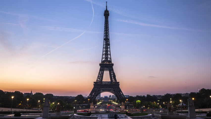 Wide shot of tourist and traffic moving on street near Eiffel Tower, Paris, France | Shutterstock HD Video #1017052039