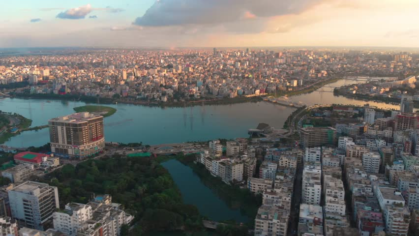 Stunning aerial drone hyperlapse shot of Dhaka, Bangladesh during sunset.