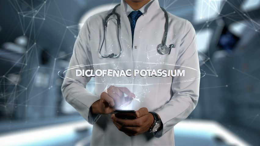 DICLOFENAC POTASSIUM - Male Doctor With Mobile Phone Opens and Touches Hologram Active Ingrident of Medicine | Shutterstock HD Video #1017094396
