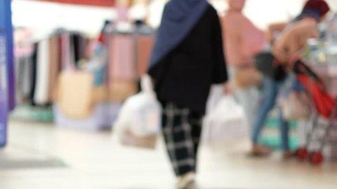 slow motion of Blurry walking people in market