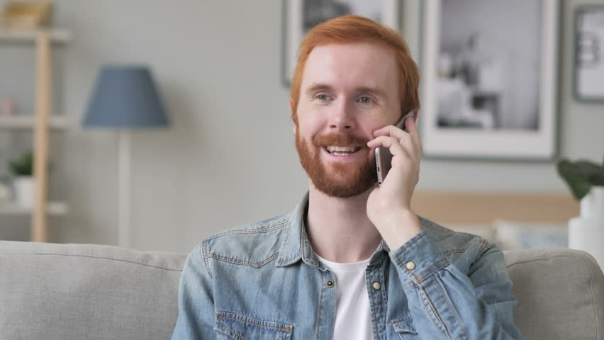 Creative Beard Man Talking on Phone, Discussing Work | Shutterstock HD Video #1017129130