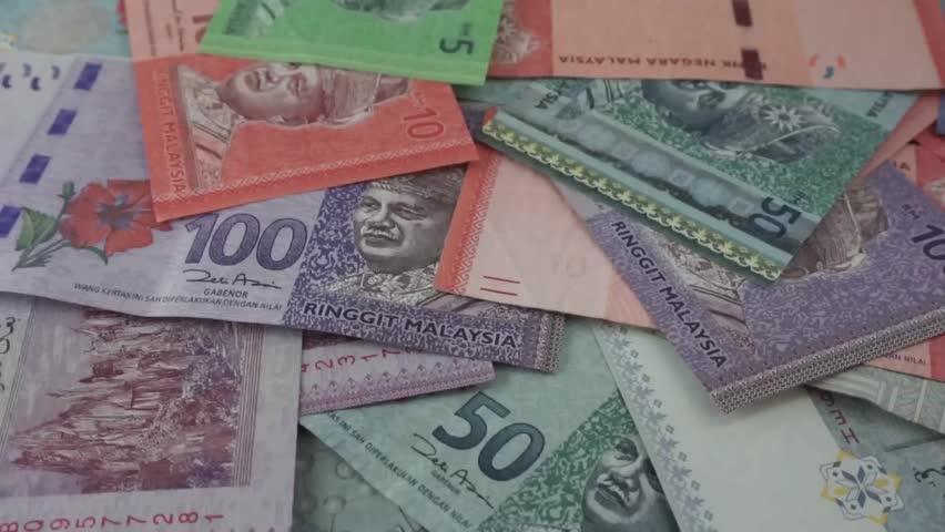 Ringgit Malaysia banknotes of various values are scattered on the table. (selected focus) Royalty-Free Stock Footage #1017157474