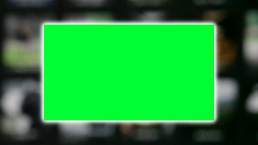 A green screen on a scrolling background of blurred pictures. | Shutterstock HD Video #1017203527