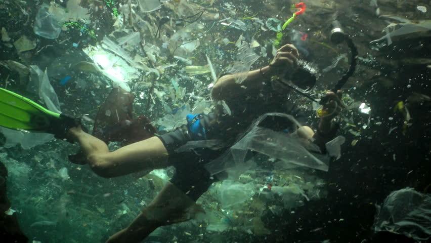 Plastic garbage and other debris floating underwater. Marine pollution. Plastic debris in the water, killing wildlife. Black Sea, Bulgary