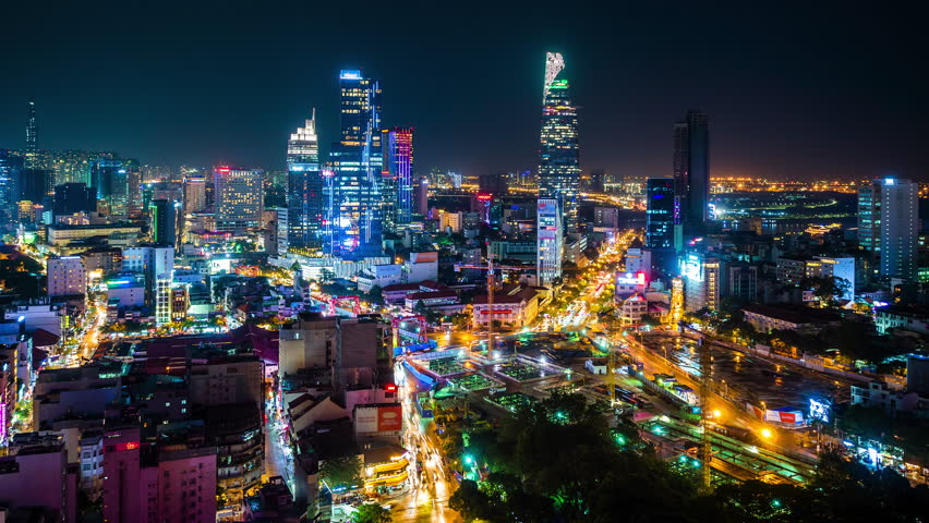 Time lapse view of Ho Chi Minh City aka Saigon, Vietnam, showing landmark buildings and traffic in the financial district at night.