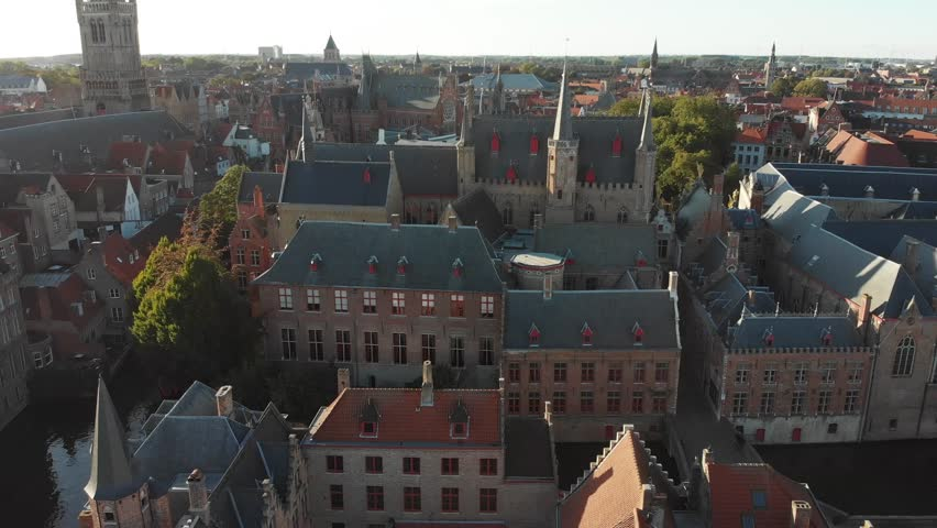Aerial view of the streets of Bruges, Belgium - a World Heritage Site of Unesco - with views of old houses with drone flying forward. Royalty-Free Stock Footage #1017269959