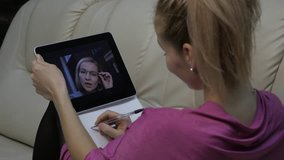 video conferencing with tutor. Young woman having online education at home. Distance education. slow motion
