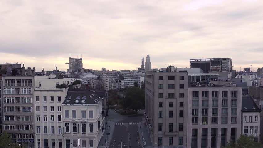 AERIAL: rising above concert hall in antwerp belgium with notre dame cathedral in the background