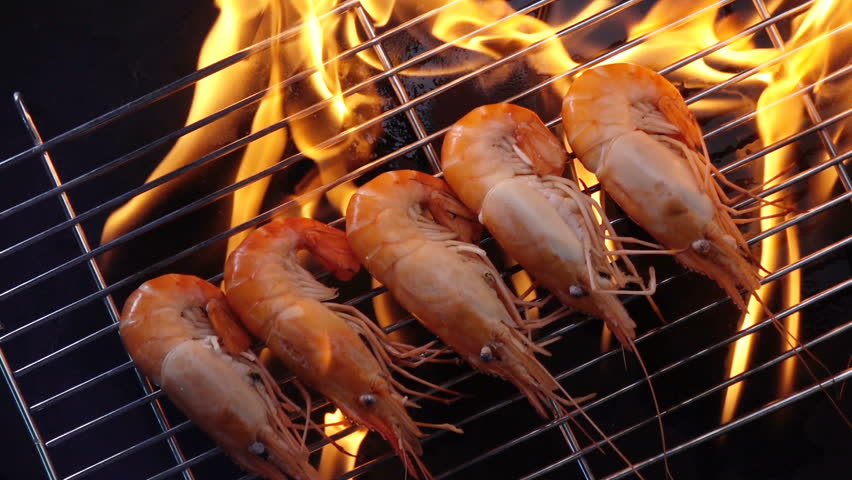grill shrimp , barbecue sea food on fire flaming slow motion background. Royalty-Free Stock Footage #1017313621