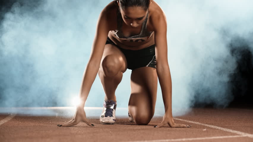 Asian Athlete ready to start. Young female runner preparing for blasting off in mist on sports track of stadium, training before competition 4k Royalty-Free Stock Footage #1017373828