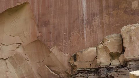 Native American Petroglyphs on red rock inside of the Capital Reef National Park in Southern Utah, USA.