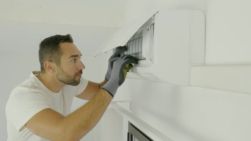 handsome young man electrician installing air conditioning in a client house  Royalty-Free Stock Footage #1017407341