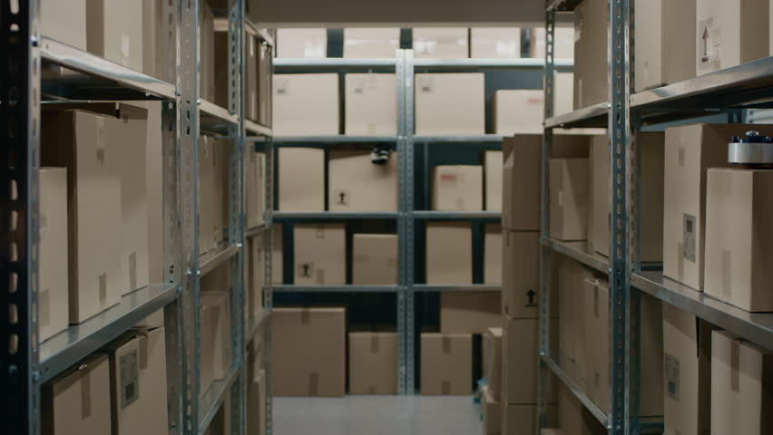 Zooming In Moving Shot Inside Warehouse Storeroom with Rows of Shelves Full Cardboard Boxes, Parcels, Packages Ready For Shipment. Shot on RED EPIC-W 8K Helium Cinema Camera. Royalty-Free Stock Footage #1017422674