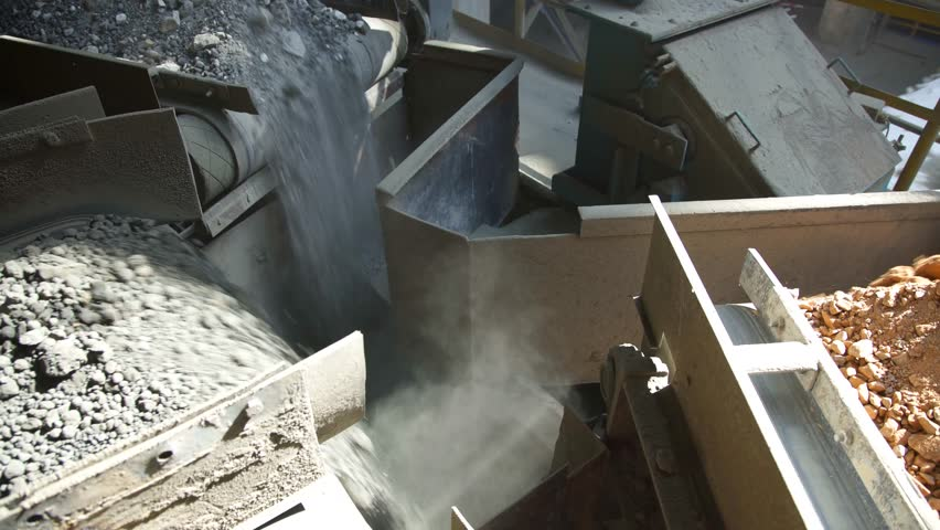 Cement factory. Conveyor with stones and gravel, tonnel. Modern technologies work at a cement plant. Technological work on the production of cement. Working atmosphere with copy space
