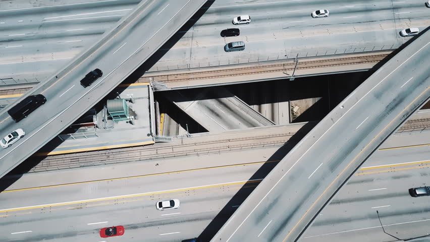 Drone flying above amazing multiple level structure of Judge Pregerson highway road junction with bridges and flyovers. | Shutterstock HD Video #1017469780