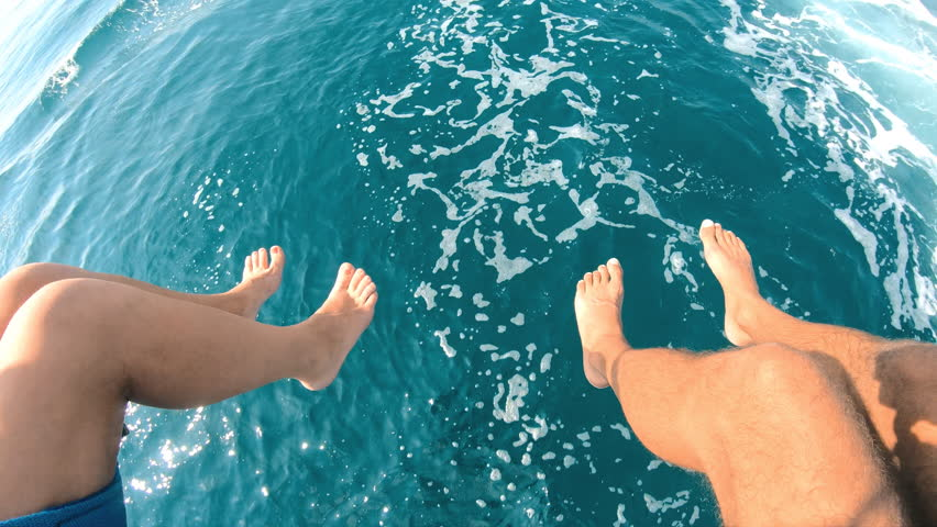Parasailing. A guy with a girl on a parachute.Enjoying the flight.Lowering your feet in the sea on the go.Water entertainment.Towing a boat .Gopro. | Shutterstock HD Video #1017470422
