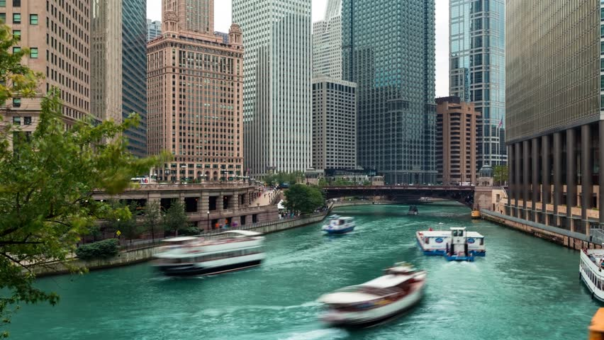 Time-lapse of boats travling on the Chicago River in Downtown Chicago
