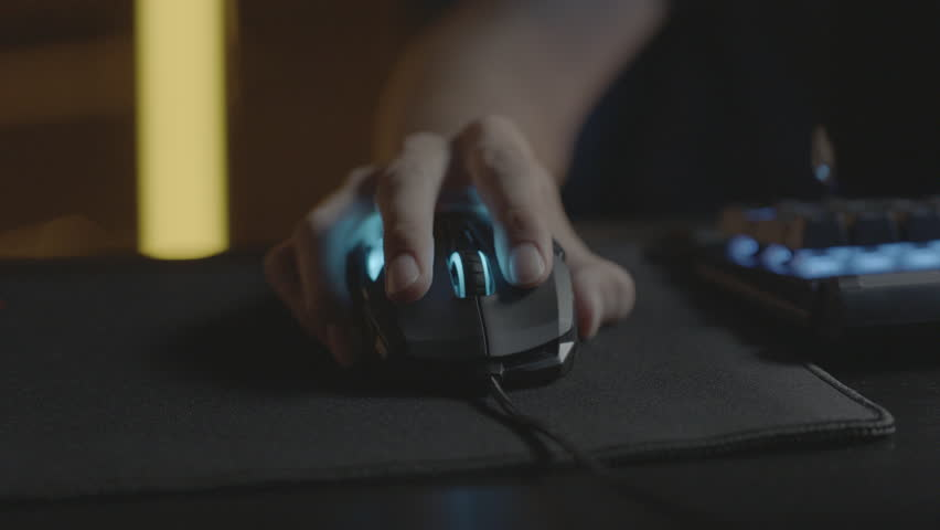 Video gamer or hacker. Hands on computer keyboard and mouse with RGB backlight. Close-up dolly panning. Shallow depth of field Royalty-Free Stock Footage #1017513670