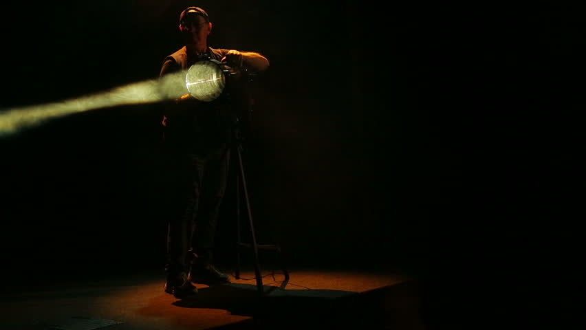 A man illuminator works with specialized spotlights. | Shutterstock HD Video #1017515800