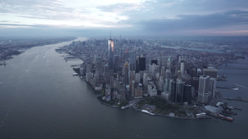 New York City Circa-2015, daytime wide angle aerial view of of Manhattan's skyline from New York Harbor over the Financial District