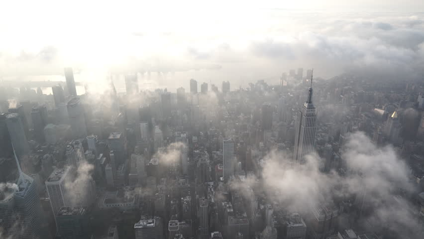 New York City Circa-2015, aerial view flying south over Midtown Manhattan at sunrise, facing the East River, with low level clouds   Shutterstock HD Video #1017520156
