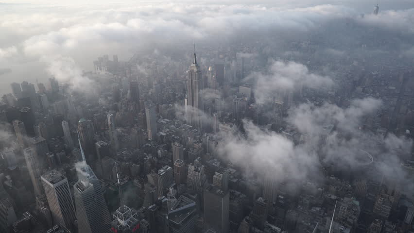 New York City Circa-2015, aerial view of from Midtown Manhattan looking south, with low level clouds at sunrise