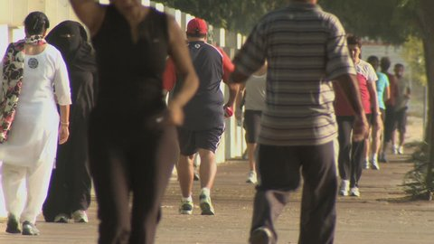 DUBAI, UAE - CIRCA September 2017: runners and walkers exercising on a busy running track preparing for Dubai Fitness Challenge