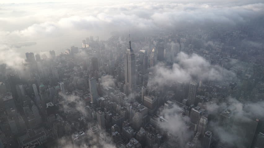 New York City Circa-2015, aerial view flying over Midtown Manhattan, featuring the Empire State Building, with low level clouds at sunrise   Shutterstock HD Video #1017553471