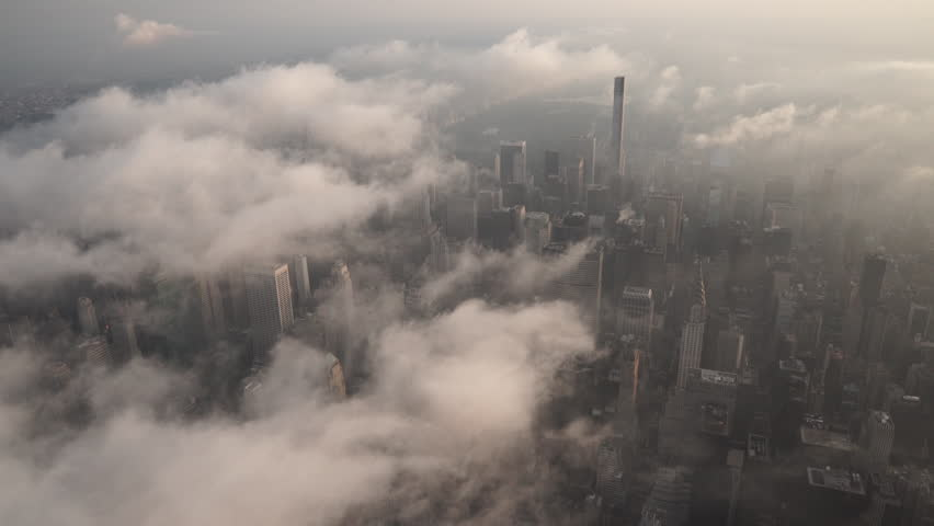New York City Circa-2015, aerial view flying over Midtown Manhattan skyscrapers under fog and low level clouds at sunrise   Shutterstock HD Video #1017554038