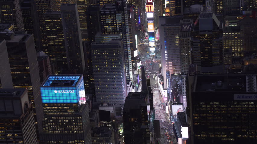 New York City Circa-2015, telephoto aerial view approaching Time Square at night